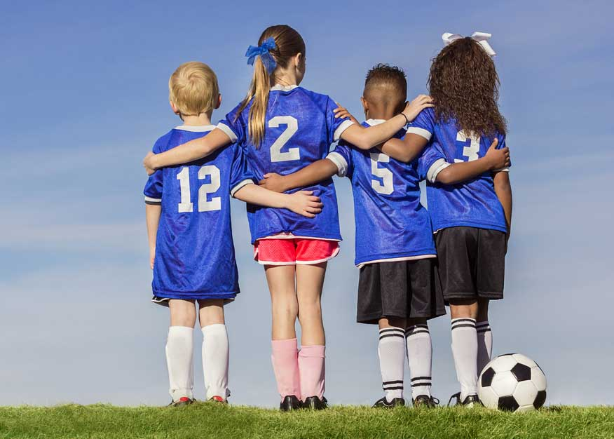 Kids embracing teamwork in sports